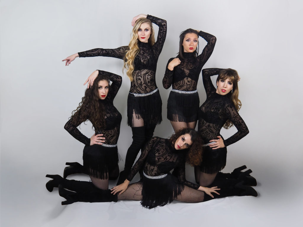 Jazz dancers in black leotards.