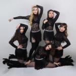 Jazz dancers in black leotards.