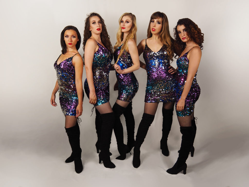 Jazz dancers in sequin dresses